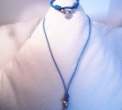 collar-cruz-pulsera-azul